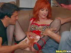 Mature redhead Sasha Brand gets double teamed