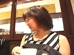 Enticing Japanese lady with glasses puts her big breasts on