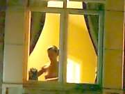 Naked in Hotel window