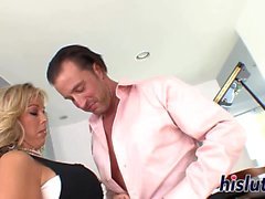 Busty housewife rides on a massive boner