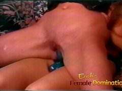 Two curvaceous lesbian sluts bang each other with a strap-on