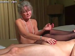 Beautiful grey haired grandma gives a footjob