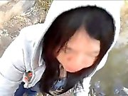 Oriental girl taking his cum within the park and stroking h