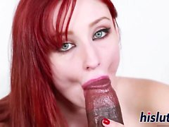Stunning redhead babe pleasures a BBC orally