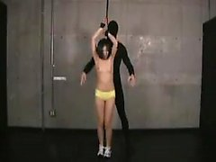 A couple of hot slaves are strung up and get their boobs hu