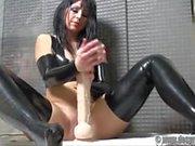 German MILF Desyra Noir in PVC playing with her monster dildo