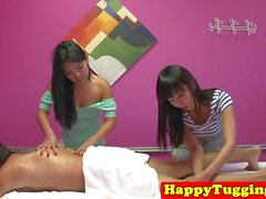 Asian masseuses tugging and cockriding client