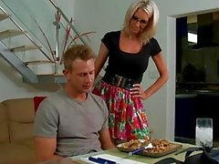 Blonde babe in glasses Emma Starr gives titjob