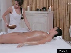 Babe gets pussy rubbed by masseuse