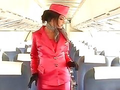 Stewardess opens wide all holes for two big dicks