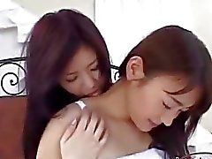 Asian Girl In Skirt Getting Her Nipples Sucked Kissing Other Girl Rubbing Her Tits And Pussy On The Bed