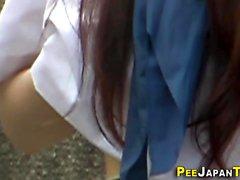 Rubbing asian urinates