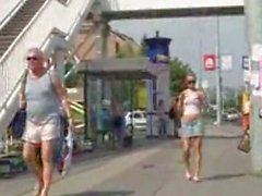 Girl nude in Public and kicked by an old man.