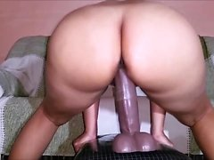 Big booty housewife has a huge black dildo making her snatch all wet