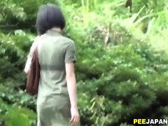 Asian ho pees outdoors