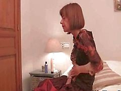 Scrawny grandma fucks herself with big dildo