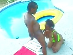 Black Sex next to a swimming pool