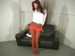 Brunette Ginger Jolie playing around and teasing in her nylons