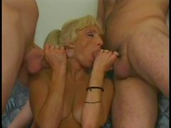 Blonde Mature Slut With A Shaved Pussy Sucks Cock While Getting