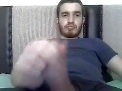 Секси мальчик показывая его мясистый микрофон