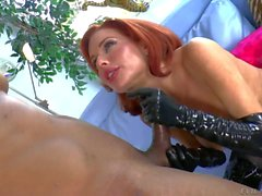 Buxom redhead Veronica Avluv in latex gloves gives head