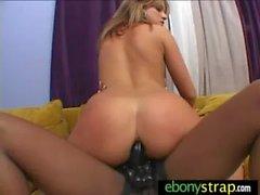 Lesbo Honey takes a strapon from ebony Hottie 17