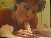 Mature blonde sucks on a big white cock in her mouth and gets fucked in retro