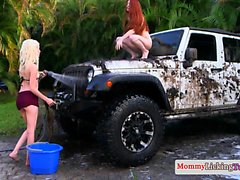 Ginger MILF pussylicks teeny on dirty car