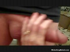 Blonde mature Melanie gives JJ a POV blowjob and fingers pussy