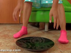 Euro chick Mea Melone pissing in the kitchen