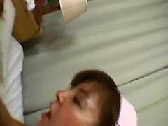 Seductive Oriental nurse in lingerie takes a hard drilling
