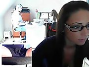 Sultry brunette secretary with glasses exposes herself in t