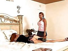 Two pale brunette lezzies play with strapon in bedroom