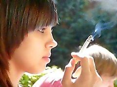 Candid brunette beauty smoking!