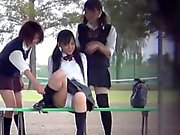 Asian teens pee outside