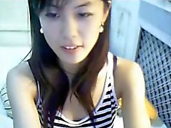 Cute Chinese girl plays on line