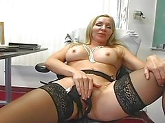 Lusty blonde teacher toys her muff in black stockings