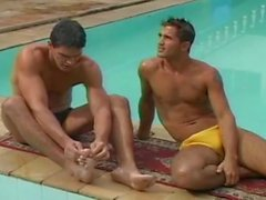 Two horny dudes and one young babe get fucked in the beside of pool