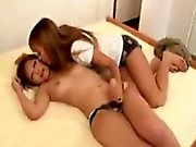 Two ravishing Oriental girls enjoy an enturous lesbian e