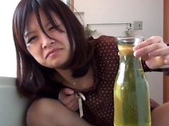 Asian fills vase with pee