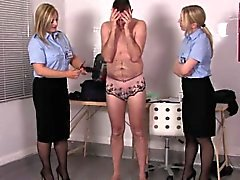 Uniformed mistresses spanking their sissy sub