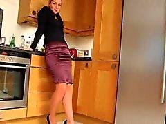 Blonde beauty in kitchen teasing hard