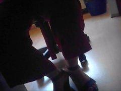 candid feet heels under desk 2