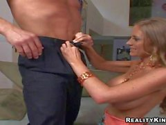 Turned on Billy Glide gets titjob by busty brunette MILF