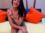 Busty brunette shows off her se and strips off on livecam