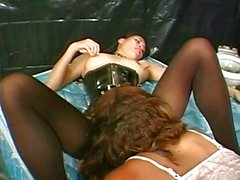 Hot babes playing with strap-on
