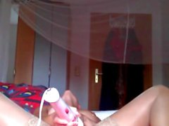 Cam girl with pierced pussy squirts in orgasm