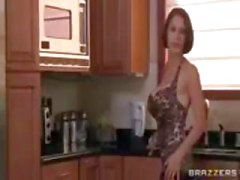Brunette MILF, with huge, fake tits, gets fucked in the kitchen