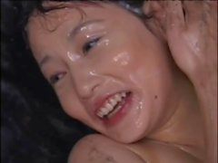 Adorable Asian cutie is coated in nut bitter at an epic bukkake party