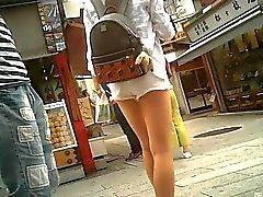 Candid white shorts and beautiful leg